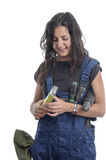 Worker woman with overalls and drill. Stock Image