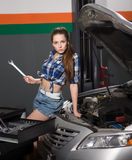Worker woman at service station Royalty Free Stock Photo