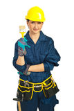 Worker woman showing paint brush Royalty Free Stock Image