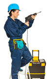 Worker woman using drill Royalty Free Stock Images