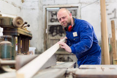 Worker at wood processing manufactory Stock Images