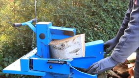 Worker with wood splitter in action, hydraulic, electric, firewood stock video