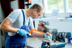 Worker on work bench in factory Royalty Free Stock Image