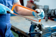Worker on work bench in factory Stock Photos