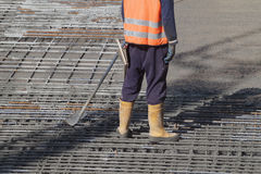 Worker. S are casting concrete or concrete with automatic pump Stock Photography