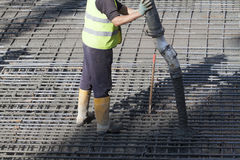 Worker. S are casting concrete or concrete with automatic pump Stock Photos