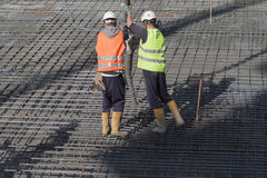 Worker. S are casting concrete or concrete with automatic pump Royalty Free Stock Photography