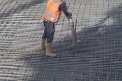 Worker. S are casting concrete or concrete with automatic pump Royalty Free Stock Image