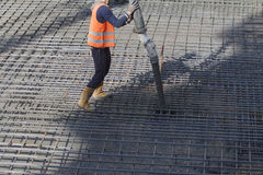 Worker. S are casting concrete or concrete with automatic pump Stock Image