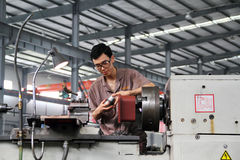 Worker working in chinese factory Stock Photo