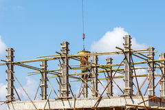 Worker working in construction on blue sky Royalty Free Stock Image