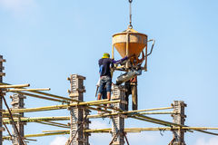 Worker working in construction on blue sky Stock Images