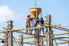 Worker working in construction on blue sky Stock Photos