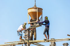 Worker working in construction on blue sky Stock Image