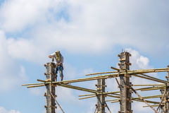 Worker working in construction on blue sky Royalty Free Stock Photography
