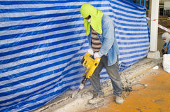 Worker working in construction site. RAYONG THAILAND , AUGUST 05 - 2016 : Worker working in construction site in Thailand Royalty Free Stock Photography