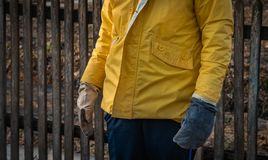 The worker is in working gloves and a working jacket.  stock photos