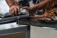 Worker working a grinding machine Royalty Free Stock Photo