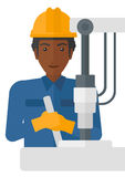Worker working with industrial equipment. Royalty Free Stock Photo