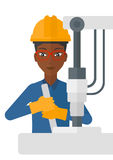 Worker working with industrial equipment. Stock Image