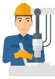 Worker working with industrial equipment Royalty Free Stock Photography