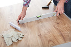 Worker working on laminate floor Royalty Free Stock Photos