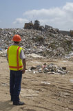 Worker Working At Landfill Site Stock Photo