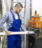 Worker working on a machine Royalty Free Stock Image