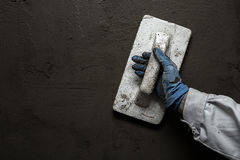 Worker working manual with wall plastering tools Royalty Free Stock Image