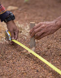 Worker working with measuring tape, hammer and nail Royalty Free Stock Photos