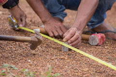Worker working with measuring tape, hammer and nail Stock Photos