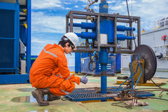 Worker working on oil and gas wellhead remote platform to perforation new production gas wells. Offshore oil and gas industry, worker working on oil and gas Royalty Free Stock Photography