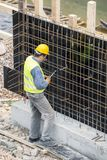 Worker working on the retaining wall stock photo