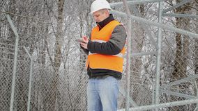 Worker working with tablet PC at outdoors stock video footage