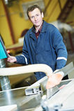 Worker at workshop with circ saw Royalty Free Stock Photography