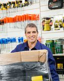Worker With Wrapped Package In Hardware Shop Stock Images
