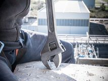 Worker with a wrench at high altitude royalty free stock photography