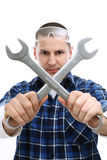 Worker with wrenches crossed Stock Photo