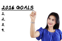 Worker writes business goals for 2016 Stock Image