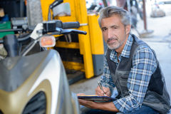 Worker writing estimate cost Royalty Free Stock Image