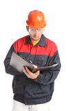 Worker writing in folder. Stock Photos