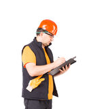 Worker writing in folder. Stock Photo