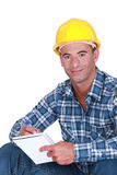 Worker writing in notebook Stock Images