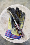 Worker's glove holding wire brush Stock Photography