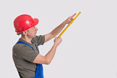 Worker with yardstick Stock Image