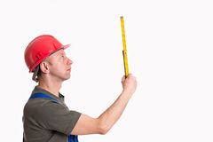 Worker with yardstick Stock Photo