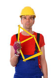Worker with yardstick- house Royalty Free Stock Image
