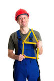 Worker with yardstick- house. In front of white background Stock Photography