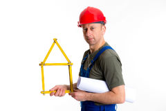 Worker with yardstick- house. In front of white background Stock Image
