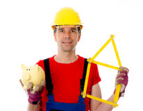 Worker with yardstick- house and piggy bank Stock Photo